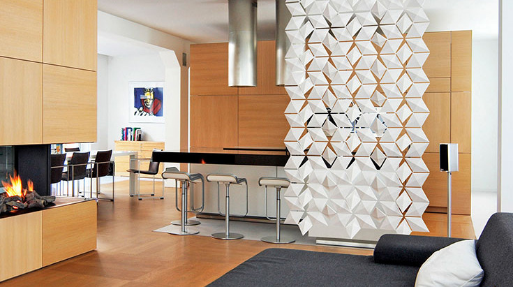 THIS SPACE DIVIDER IS EYE-CATCHING, FUNCTIONAL & INTERACTIVE!