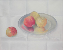 Apples on silver plate