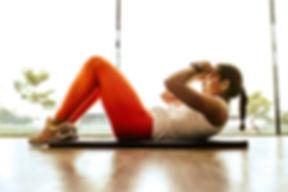 woman-wearing-orange-leggings-and-white-
