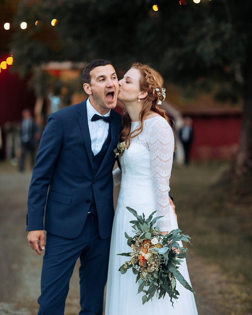 Happy kisses, wedding couple at a smal farm wedding