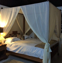 Four poster contemporary bed