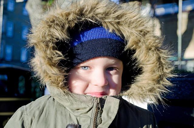 Kid wearing a warm donated jacket.
