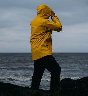 Adult Caucasian male in yellow raincoat