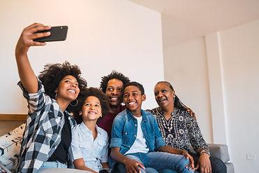 multigenerational-family-taking-selfie-with-phone-home.jpg