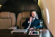 Businessman flying on his private jet.jp