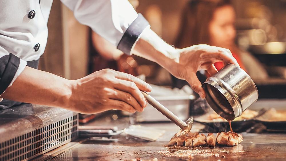Chef preparing chicken dish