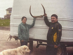 Conrad and Veronica Spence posing with the horn-like antlers of the underwater moose