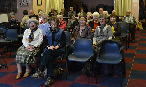 Members at indoor meeting.