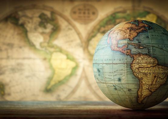 Old globe on vintage map background. Sel