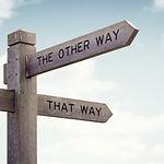 Crossroad signpost saying this way, that