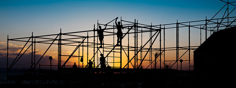 Construction workers working on scaffold
