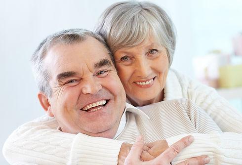 senior-couple-hugging-home_edited.jpg