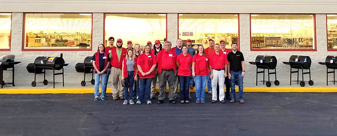 Hardware store employees in front of store