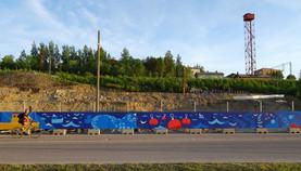 Fence mural to a new neighborhood in Tampere. Uusi Santalahti - Pisparannan kortteli. Pohjola Rakennus Oy Häme, 2018