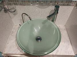 Glass counter top basin in en suite built by Lemontrade