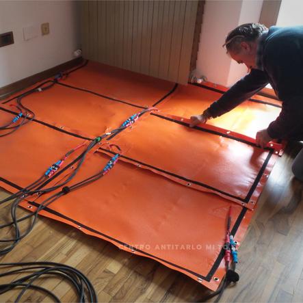 Trattamento parquet in legno di olivo con pannelli termici modulari infrarossi ad onda lunga MI.TO.S.
