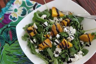 Seasonal Potluck arugula salad with beets, goat cheese balsamic reduction