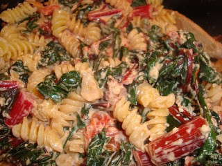 Creamy pasta with chard and tomatoes