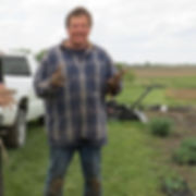 Tracy after transplanting garden plants