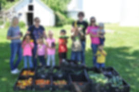 Iowa garden volunteer family