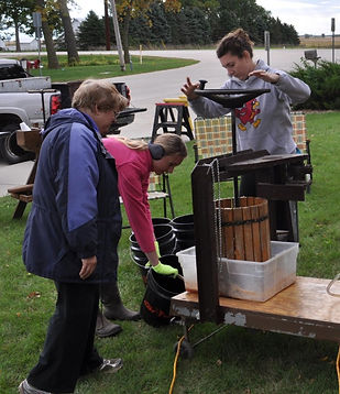 Church youth group pressing apple cider