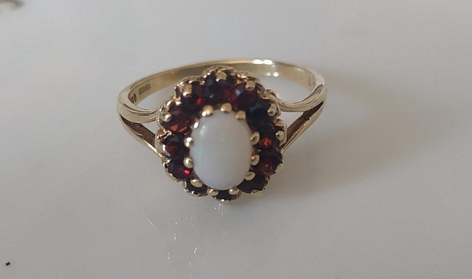 טבעת זהב אופל וגרנטים