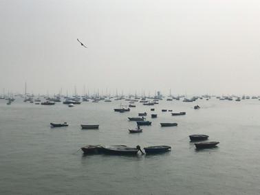 Boats through the haze of Mumbai.jpg