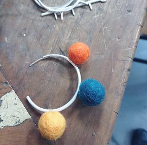 Pom pom jewellery in the making