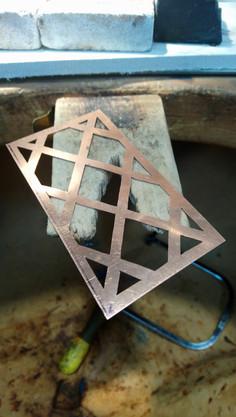 Hand cut copper lattice