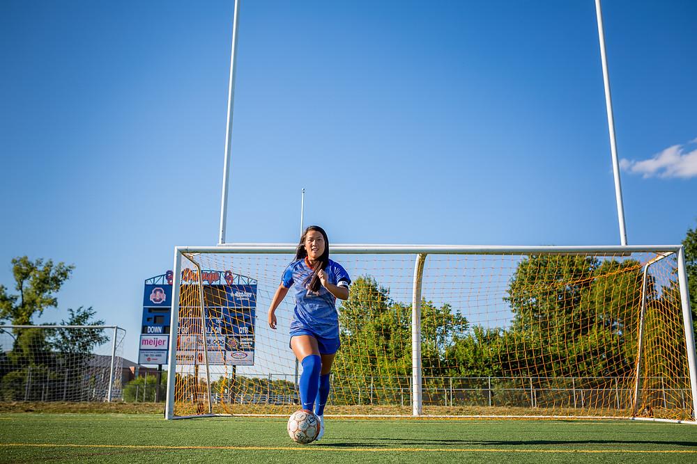 Olentangy Orange soccer player in stadium senior photo