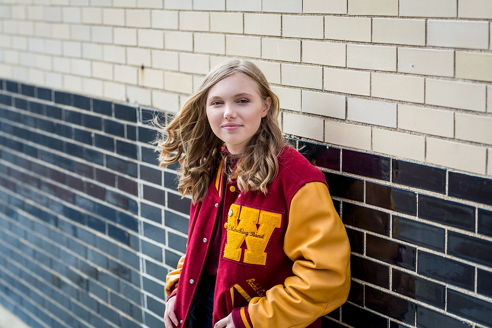 Westerville senior picture in uptown in WNHS letter jacket
