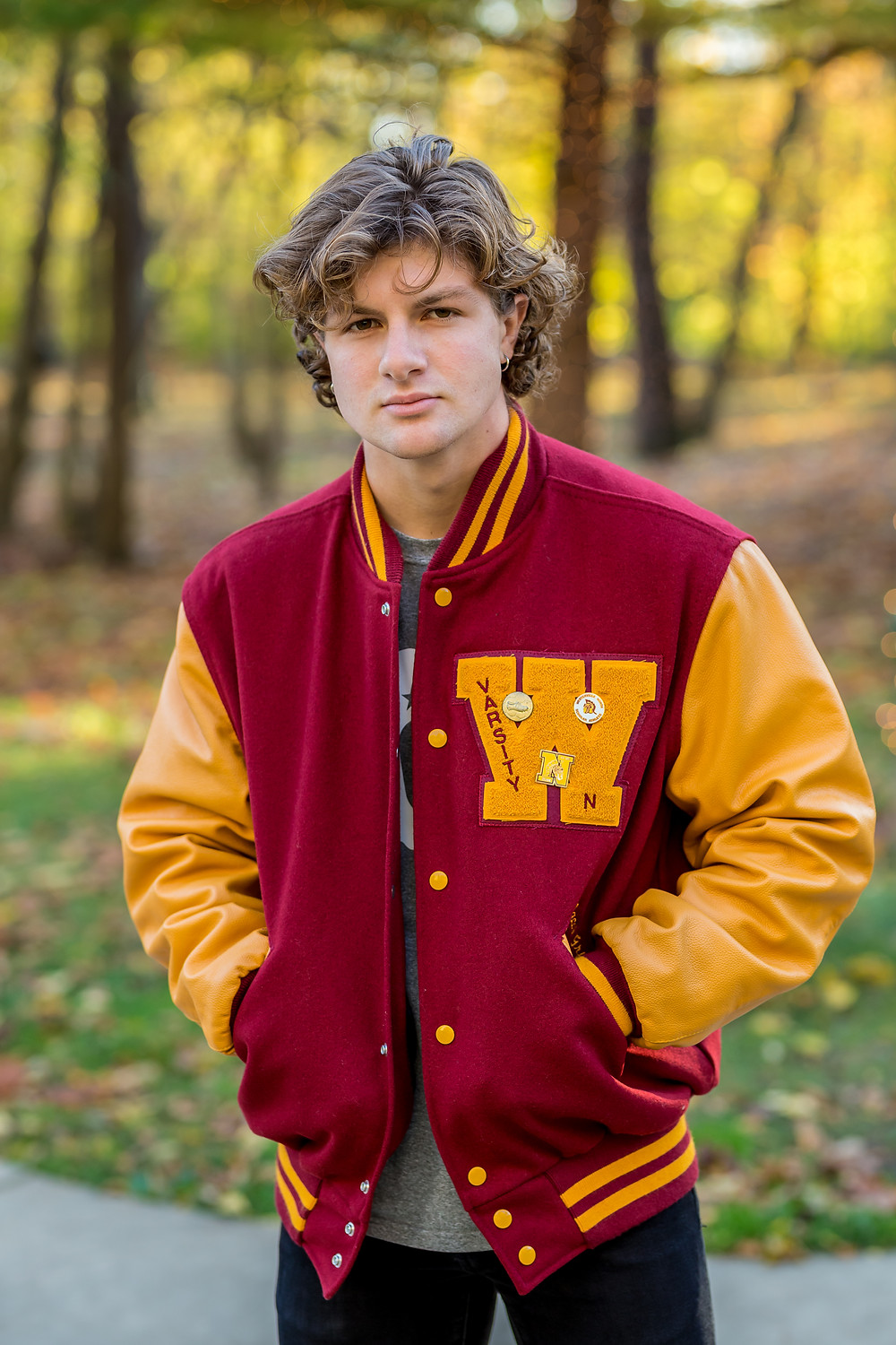 Westerville North senior in varsity jacket in park in Fall in Ohio