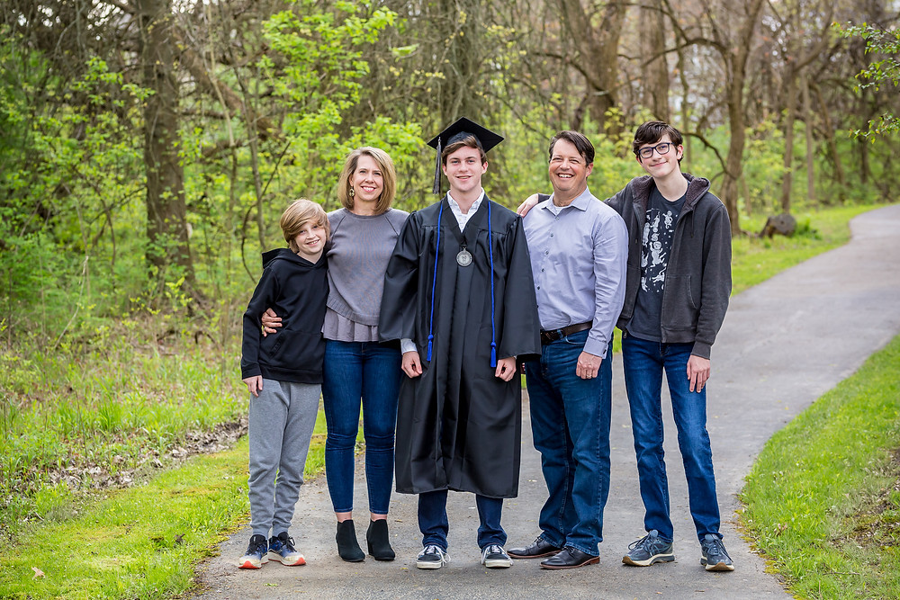 family graduation photo in cap and gown in Westerville