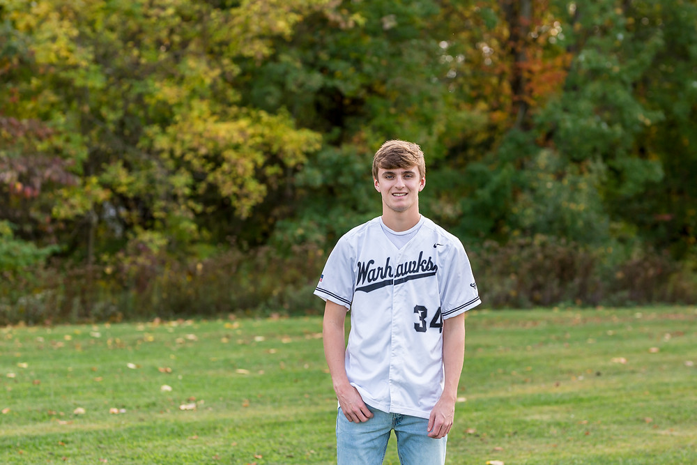 Westerville Central Baseball Senior Photo of variety baseball player in Warhawk jersey