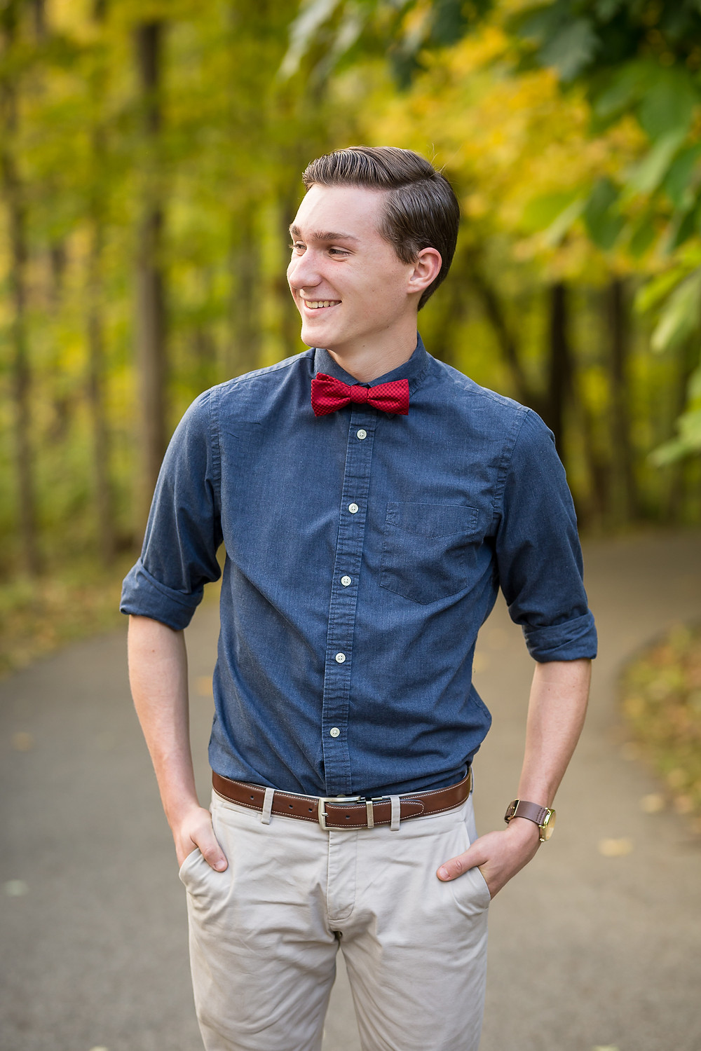 high school senior guy wearing blue shirt and red bowtie in Westerville senior photo yellow trees with Fall color October