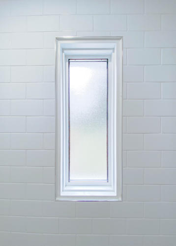 custom white tiles and window cutout