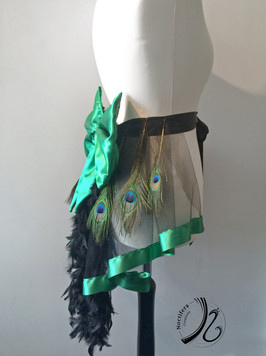 Side view of green and black bustle