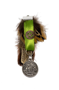 Green medal with feather and ship pendant