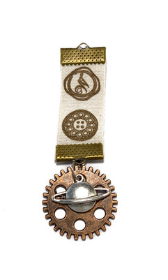 Handmade medal with  cog and planet pendant