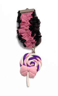 Black and pink ruffled medal with lollypop pendant
