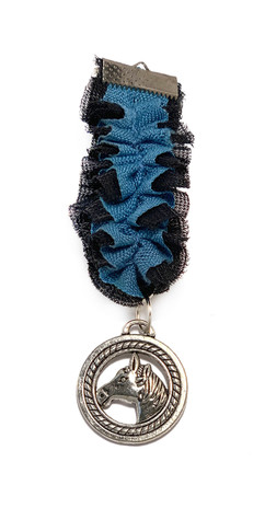 Blue and black ruffled medal with a horse pendant