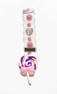 Hand embellish medal featuring a Kawaii lollypop and rhinestones