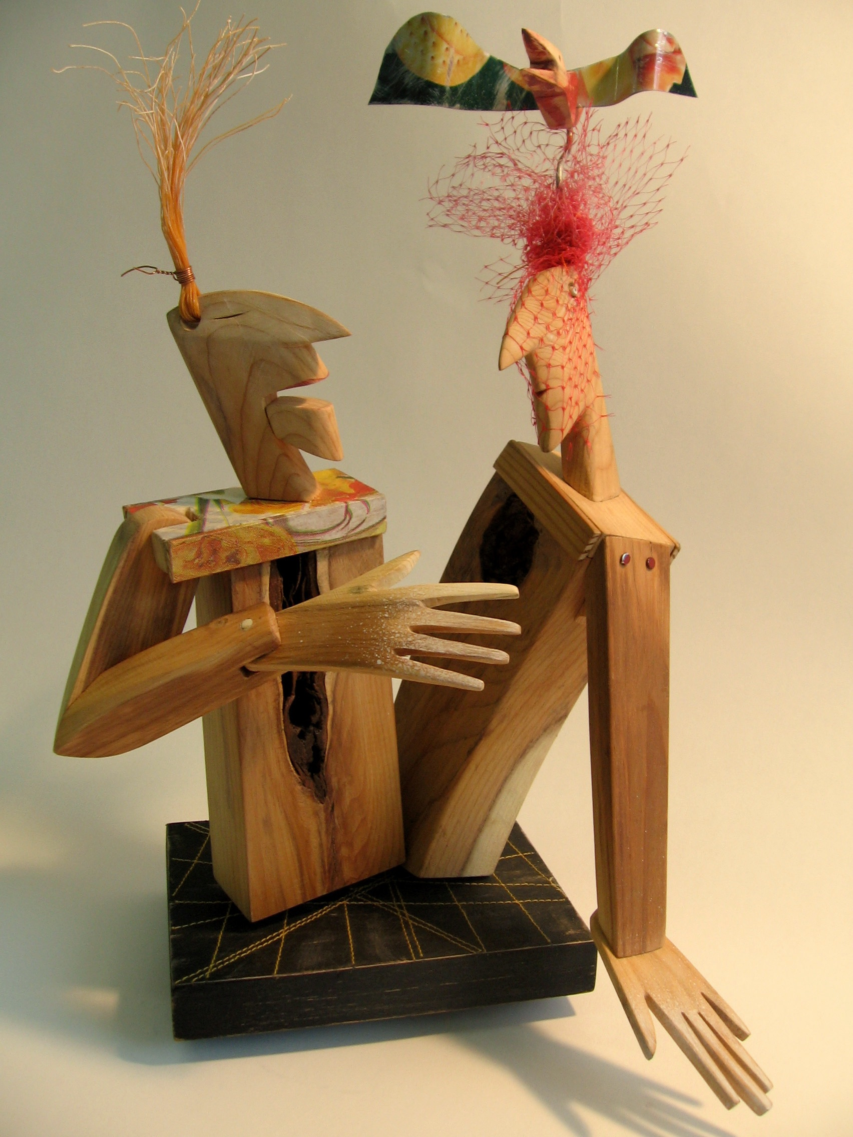 A-Z: wooden sculpture, mixed media.
