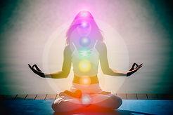 Yoga meditation hands woman in yoga lotus pose with seven chakras, aura, spiritual and Yin
