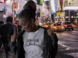 T-Shirt Mockup of a Woman Wearing a Leather Jacket - NYC Street.jpg