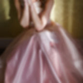 Teenage girl wearing fancy prom pink dress, posing on  school-leaving party.jpg