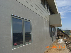 Smart SIPs home with tile overlay to the outside walls