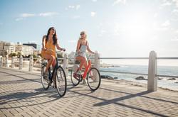 Girls on bikes at seaside shutterstock_4