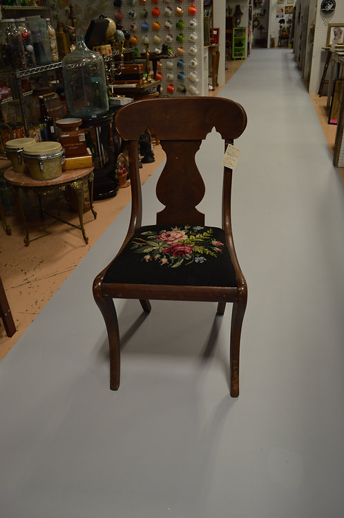 Wooden chair with needlepoint cushion