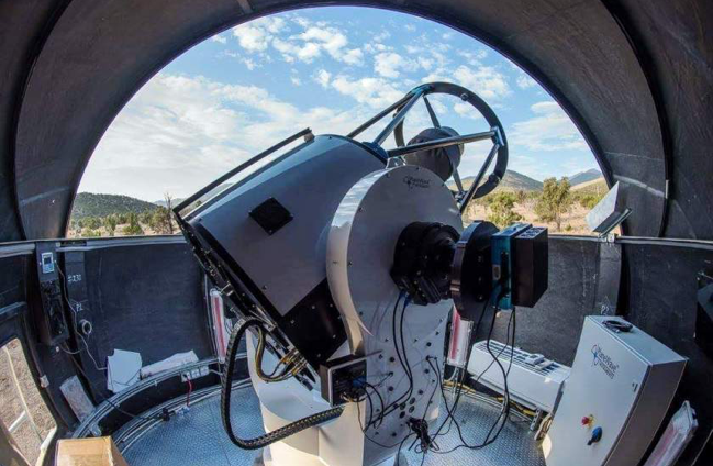 The PlaneWave Instruments CDK-700 robotic telescope at the Great Basin Observatory. The camera and filter wheel the student teams will be using are seen extending from the right side Nasmyth port of the telescope.